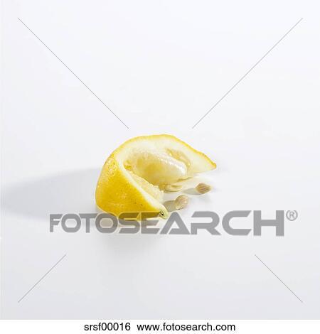 squeezed lemon slice on white background stock images