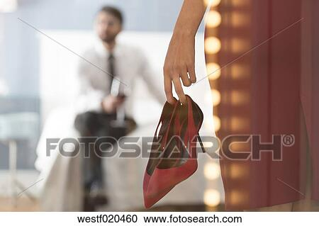 Stock Photography   Woman Holding High Heels With Man In Bedroom.  Fotosearch   Search Stock