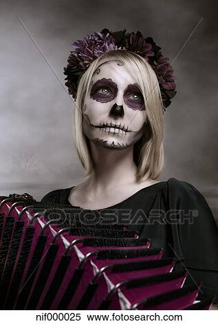 Portrait Of Woman With Sugar Skull Makeup And Accordion Stock Photography Nif000025 Fotosearch