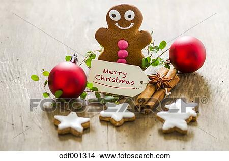 christmas decoration with gingerbread man cinnamon stars and christmas baubles