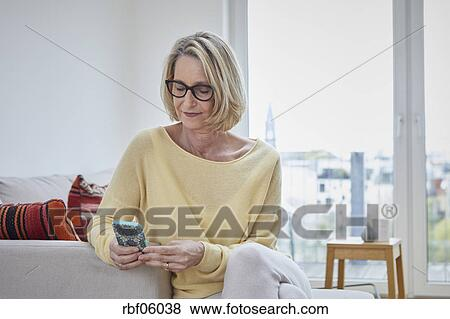Mature woman at home