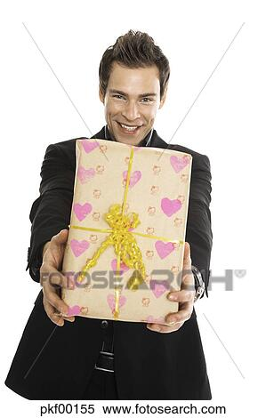 Young Man Holding Present Close Up