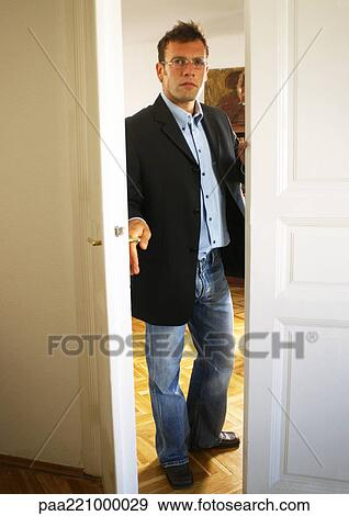 Stock Photograph Of Man Opening Door Paa221000029 Search