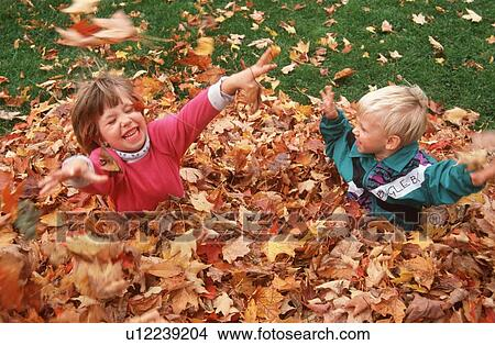 Image result for children playing autumn leaves